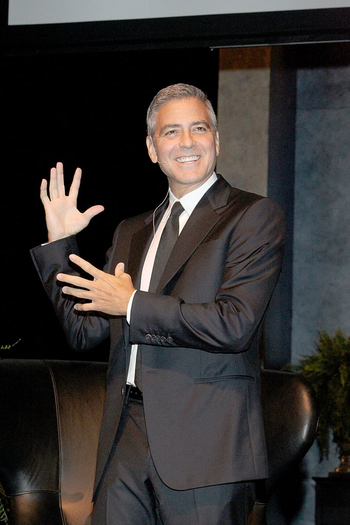 George Clooney joked around before an interview segment in Texas.