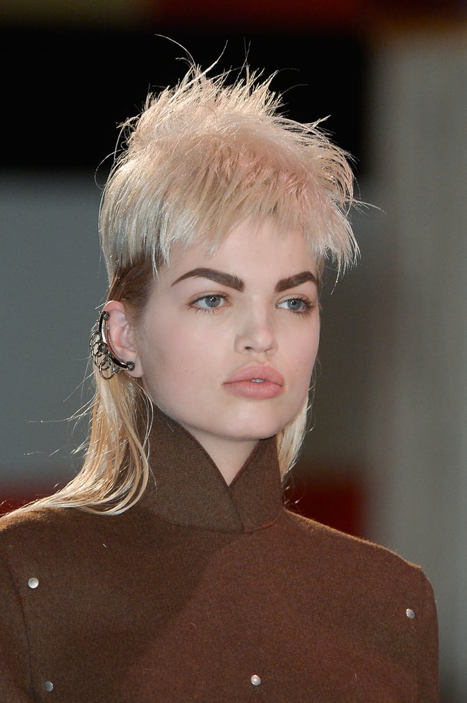 """Guido and his team cut 34 wigs individually for each model, working with each face shape on site at the show. He explained that he wanted to """"make them look as good as possible so it's like a haircut on each girl."""" Unlike other shows he's worked on this season like Marc Jacobs, these were inexpensive hairpieces as opposed to lace-front wigs."""