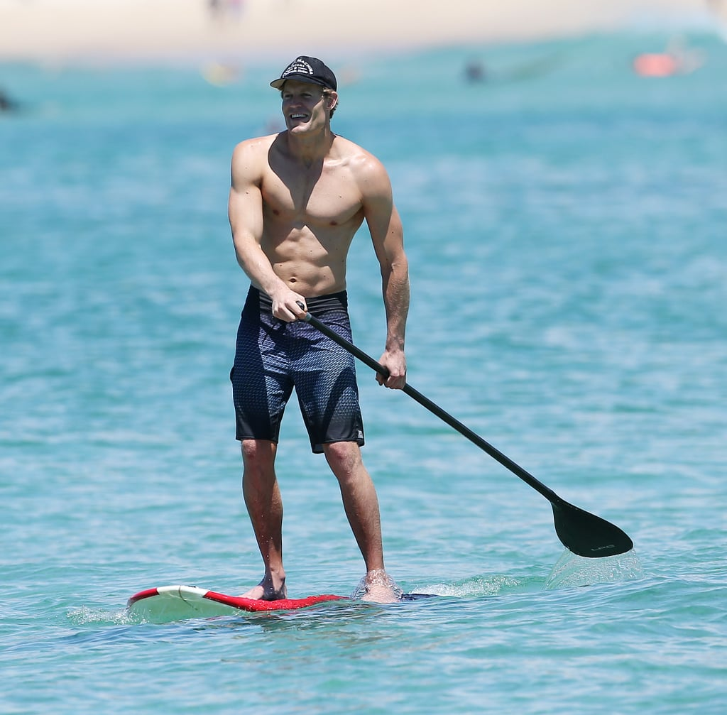 Dr. Chris Brown went paddle boarding at Bondi Beach in December 2013.