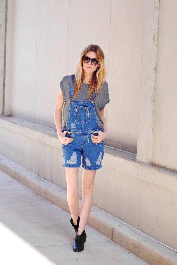 Catch the overalls trend in action — and steal her easy styling with a laid-back tee and booties. Source: Lookbook.nu