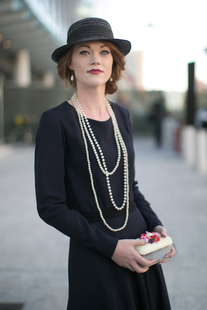 Who said hats couldn't be super chic? A low chignon makes this one fit for a night out.