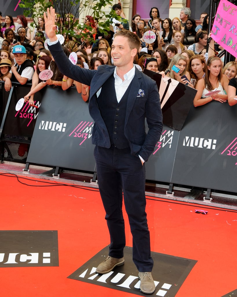 Patrick J. Adams waved to his fans.