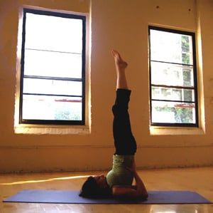 Shoulderstand Yoga Pose Will Wake You Up, Says Mandy Ingber
