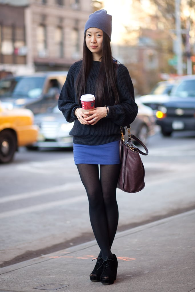 Rethink your everyday style with a warmed-up miniskirt — all you need are tights, ankle boots, and a beanie. Source: Adam Katz Sinding
