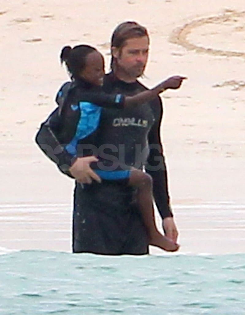 Brad Pitt and Zahara both wore wetsuits as he carried her in to the water.