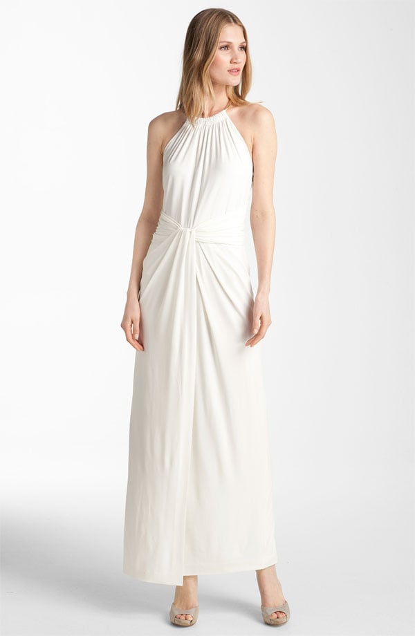 We love the modern silhouette and the ultraflattering ruching.  Calvin Klein Knot Detail Jersey Halter Gown ($178)