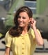 July 7th, 2011 Arriving in Calgary, Canada.   Kate wears a yellow silk Jenny Packham dress and Kiki Citrine earrings.