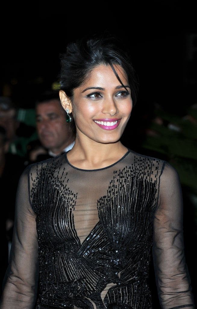 Freida Pinto paired a black sheer dress with bright pink lips for the opening dinner at the Cannes Film Festival.