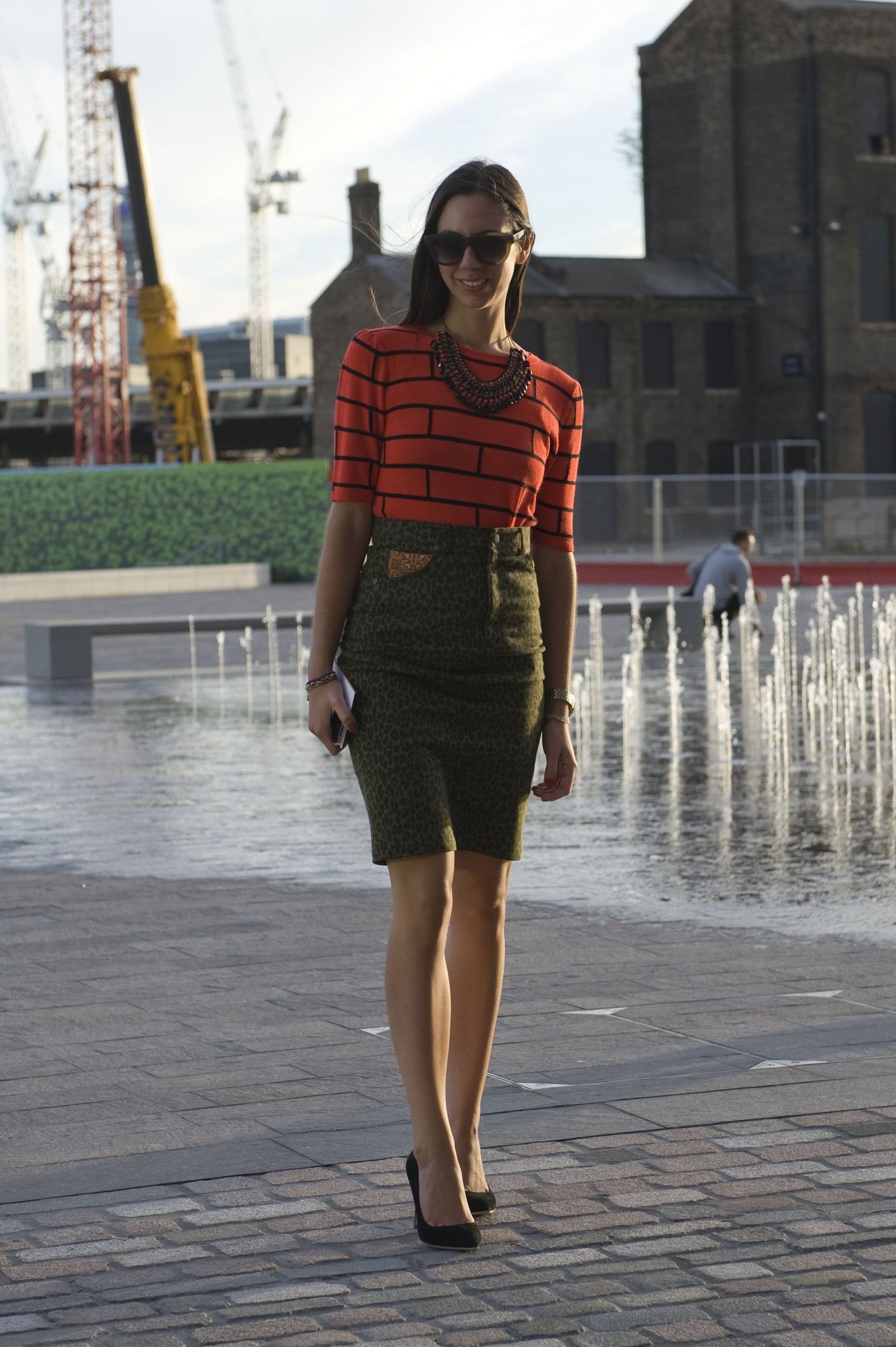 This look was Fall-perfect based on cool autumnal hues alone. Add to the mix a cheeky brick-patterned top and statement necklace, and you can't go wrong.