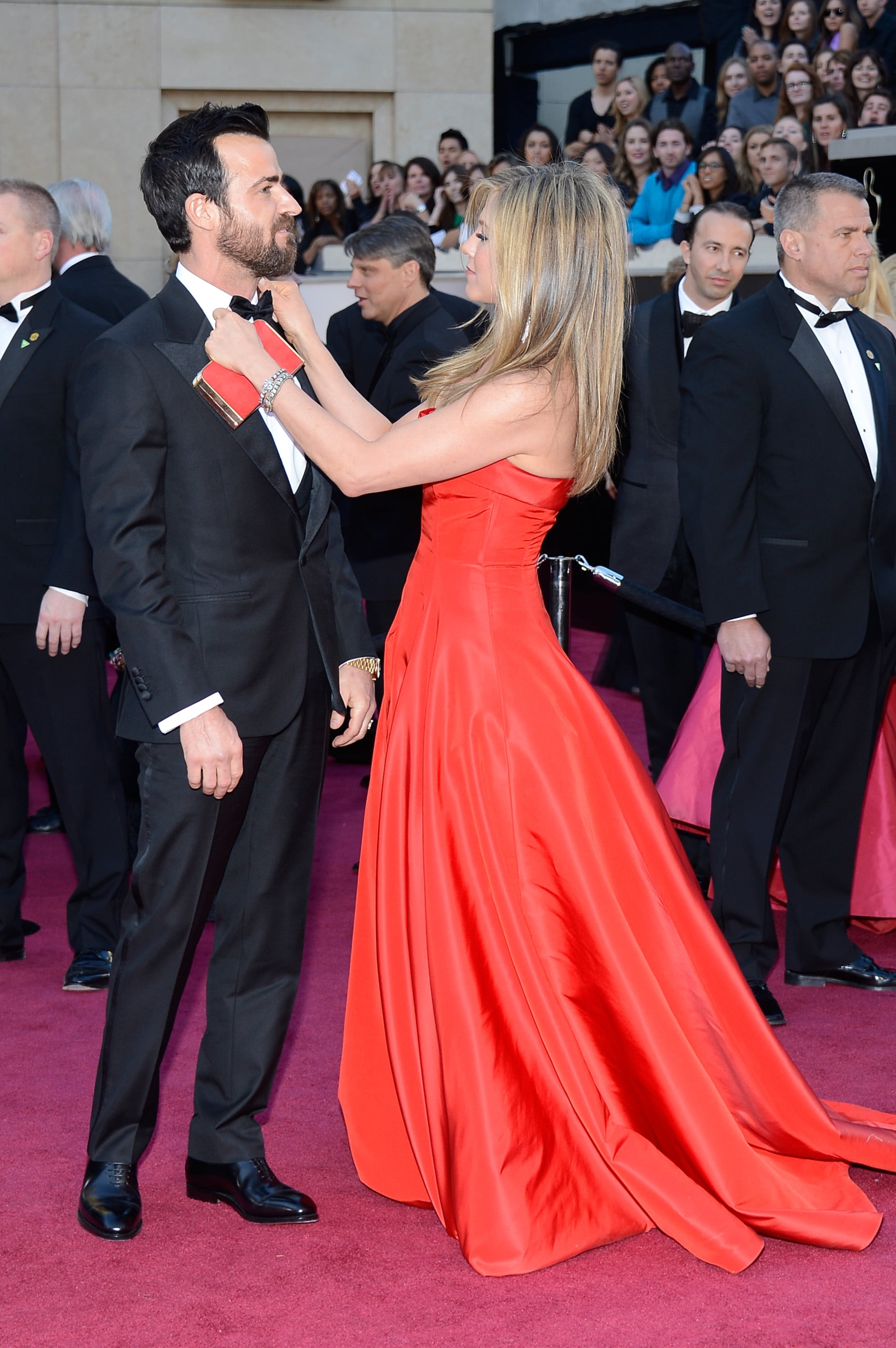 Jennifer Aniston straightened out Justin Theroux's bow tie on the Oscars red carpet.