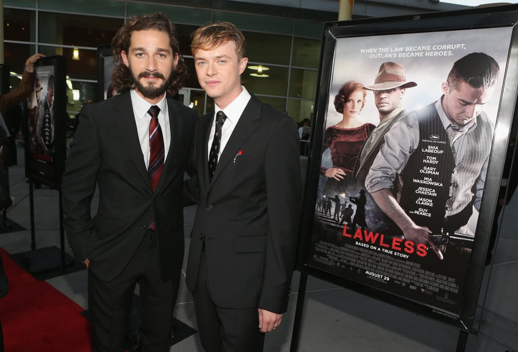 Shia LaBeouf and Dane DeHaan posed with a poster of their new film, Lawless, in the background.