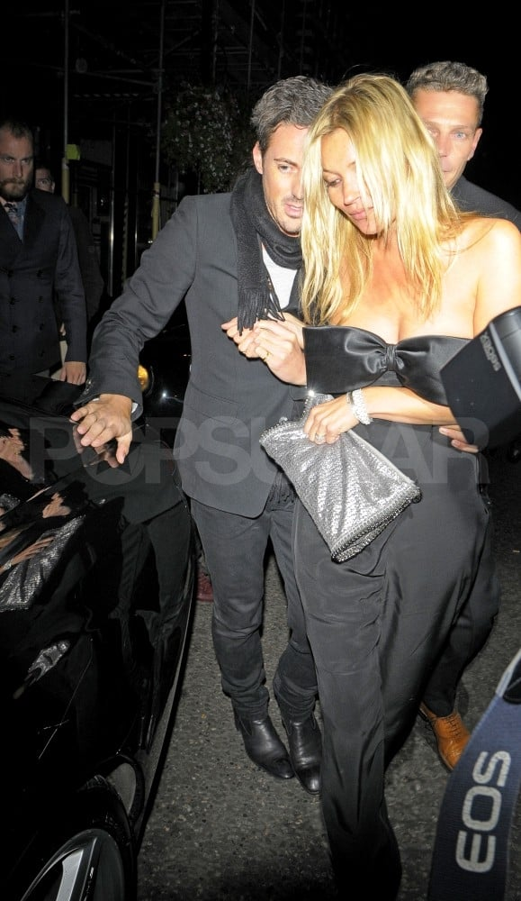 Kate Moss gets a hand after Stella McCartney's 40th birthday party.