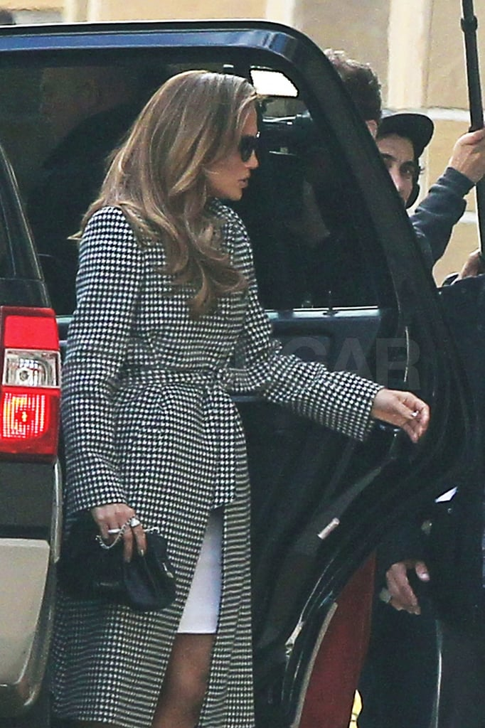J Lo wore a black and white trench to the taping.