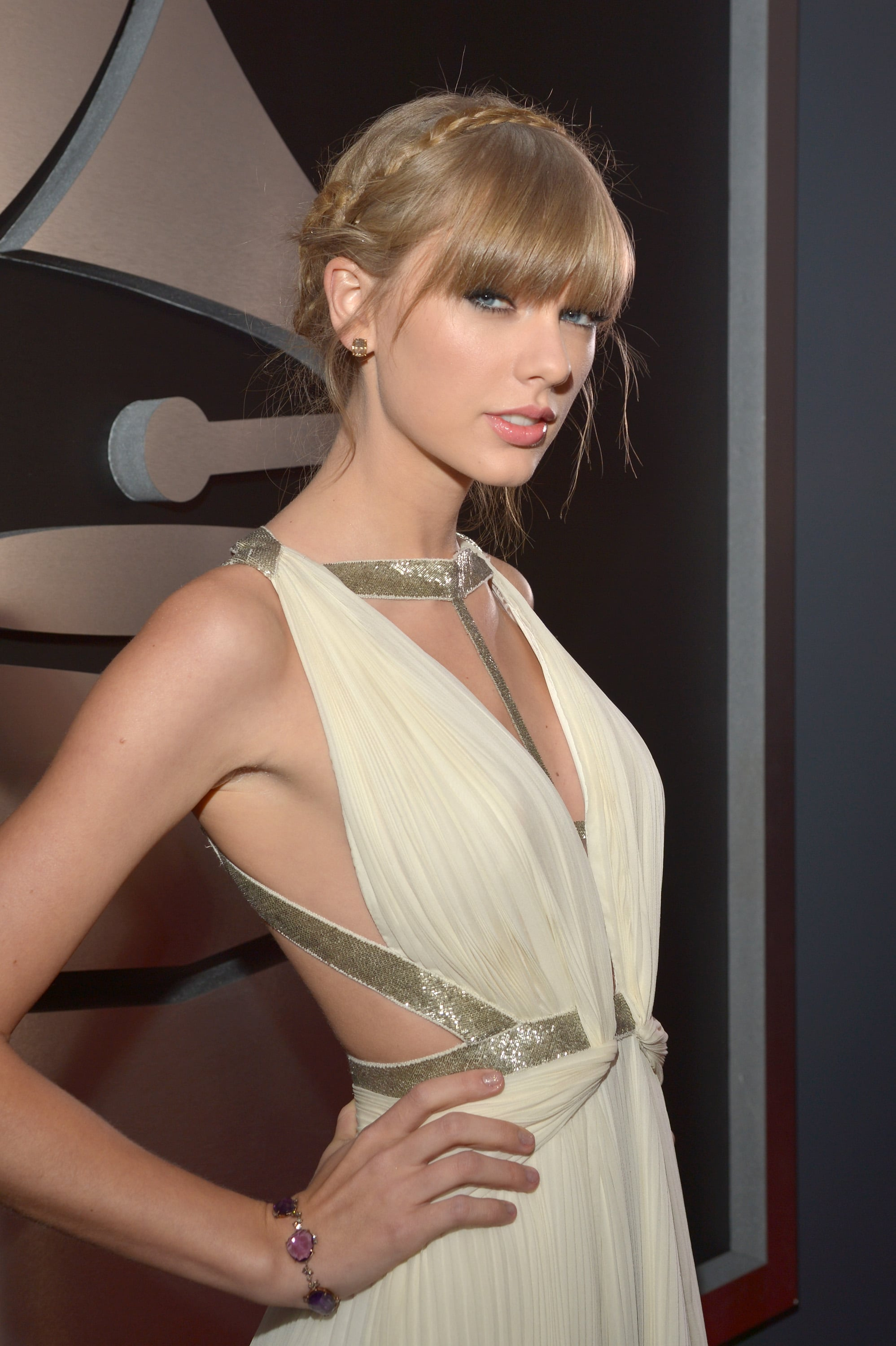 Taylor Swift posed on the Grammys red carpet before opening the show.