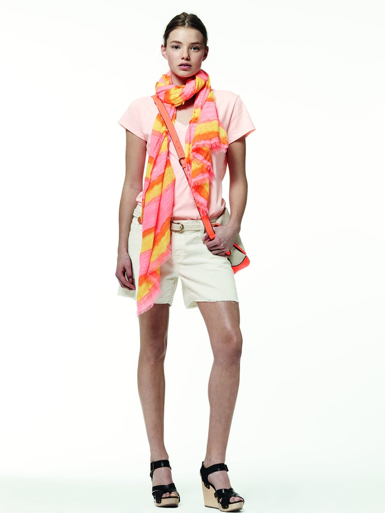 Punch up a breezy look with a vibrant scarf.