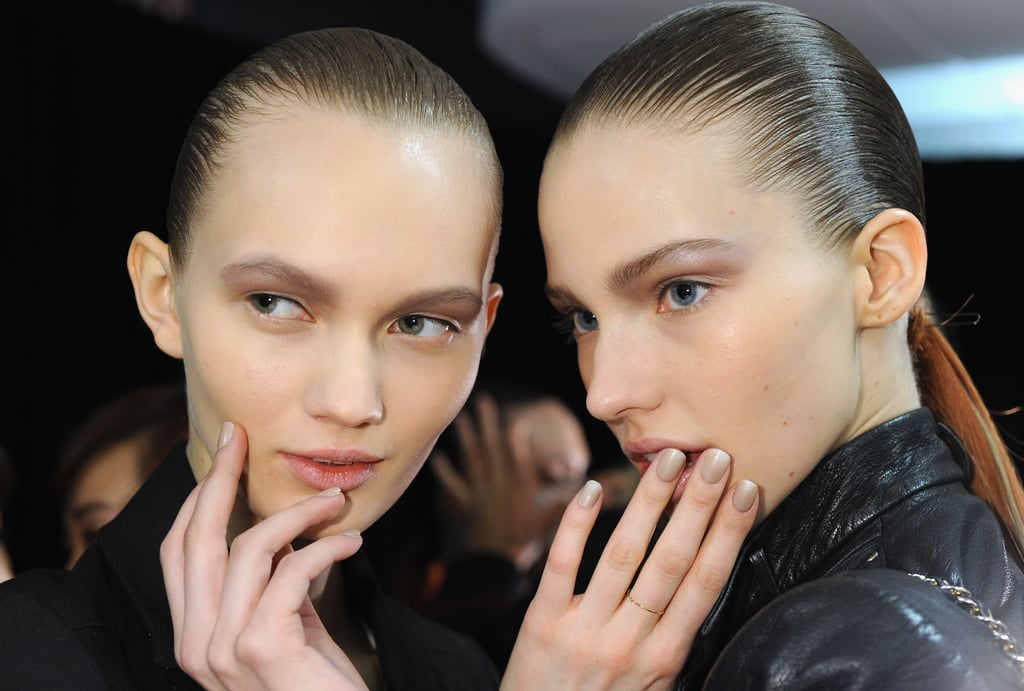 """""""He liked the idea of a hooded effect on the eye,"""" Nars lead artist Diane Kendal said. To create the shadow, Kendal swept on varying shades of gray on the lid, into the crease, and up to the brow bone. The rest of the look was kept simple, with a touch of cream blush on the cheeks and a swipe of balm on the lips."""