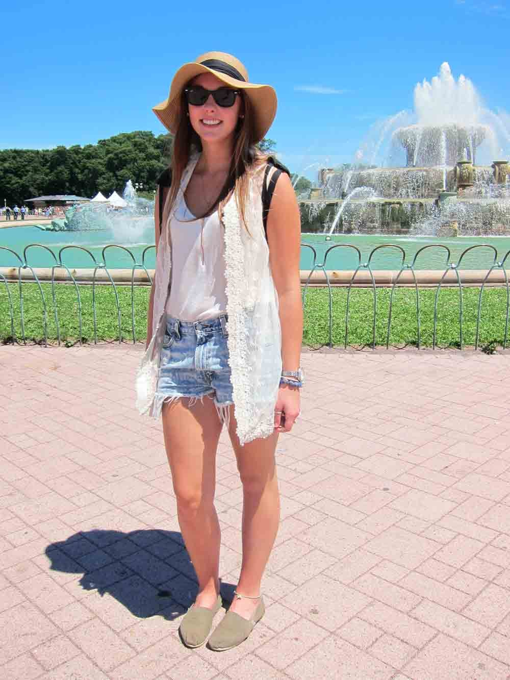 Fashion can be comfortable, as Alice proved with her loose white tank and sheer lace-lined vest. Her olive-green TOMS and Uniqlo hat — essential on an SPF-70 kind of day — were our favorite accessories.