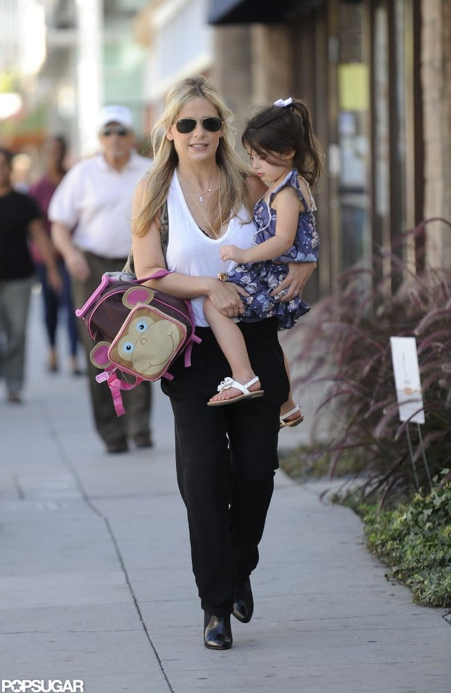 Sarah Michelle Gellar wore black pants and a white top with Charlotte Prinze in LA.
