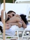 Robert Pattinson and FKA Twigs got hot and heavy in their beach chairs during a trip to Miami in December 2014.