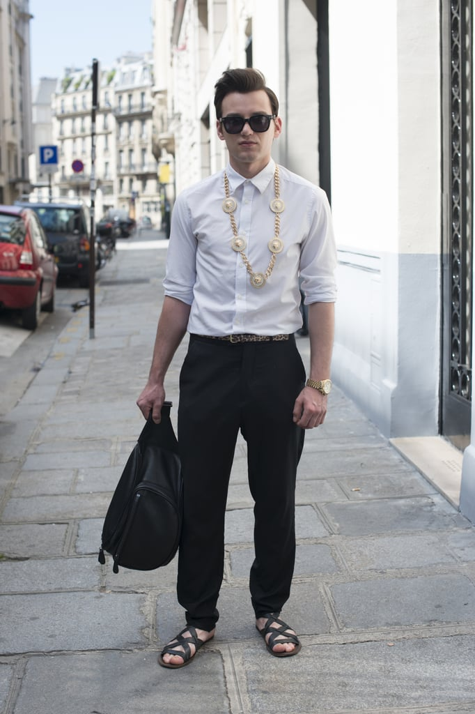A simple outfit is made by accessories like the strappy flat sandals and long necklace spotted on this fellow.