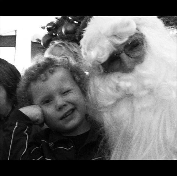 Minnie Driver's son, Henry, winked while visiting Santa Claus.  Source: Instagram user ameliawave
