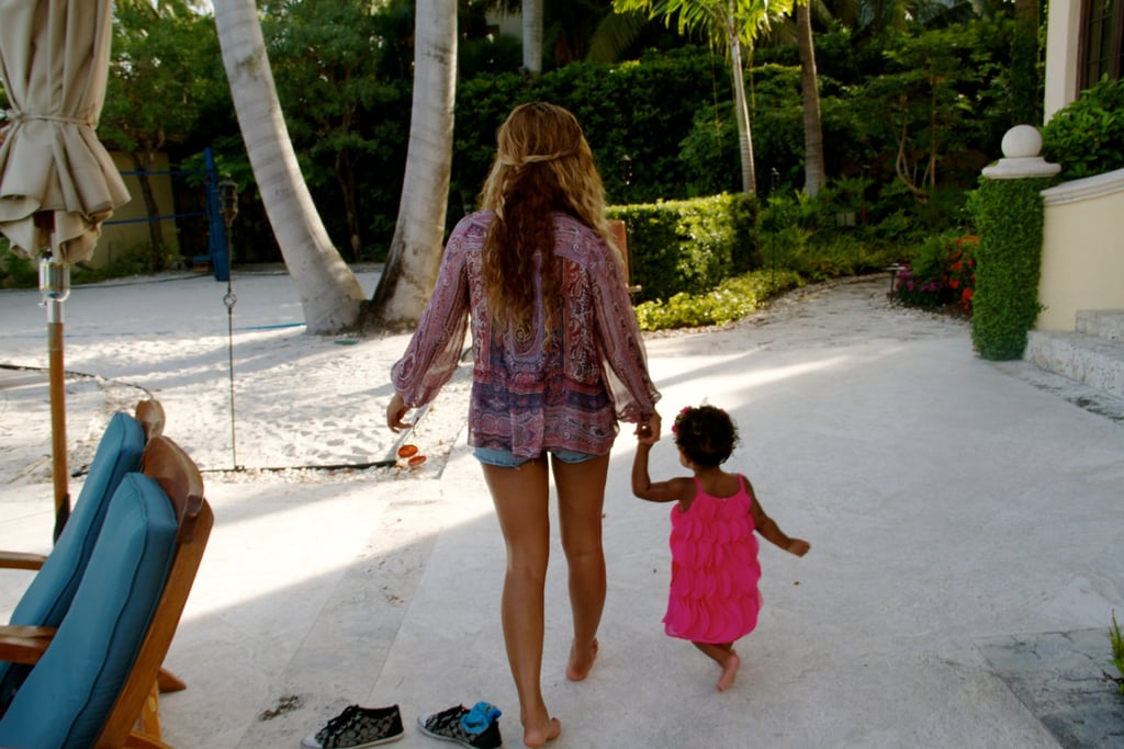 Beyoncé was led down a path by Blue Ivy while hanging in Miami in July 2013. Source: Tumblr user Beyoncé