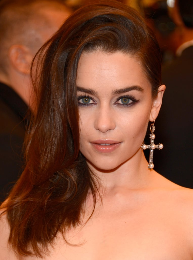 Emilia Clarke added a cool-girl touch with a single Fred Leighton cross earring.