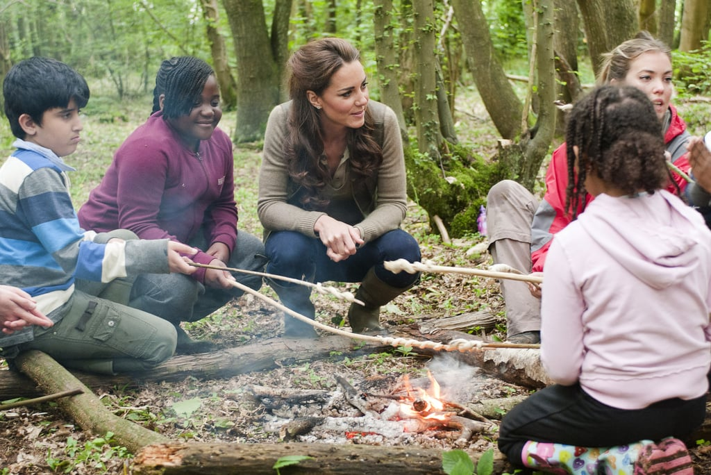Kate Middleton roasted food by a campfire with children from Expanding Horizons primary school outdoor camp.