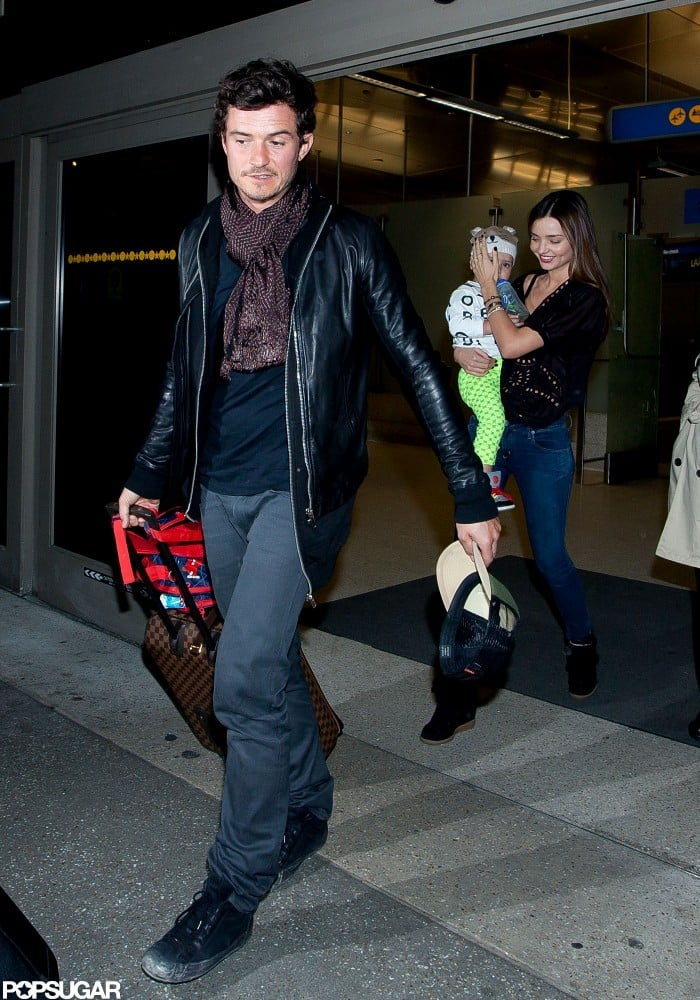 Miranda Kerr arrived at LAX with Flynn Bloom and Orlando Bloom.