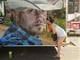 A woman kissed a picture of country singer Jason Aldean at the 2012 Downtown Hoedown at Comerica Park in Detroit.