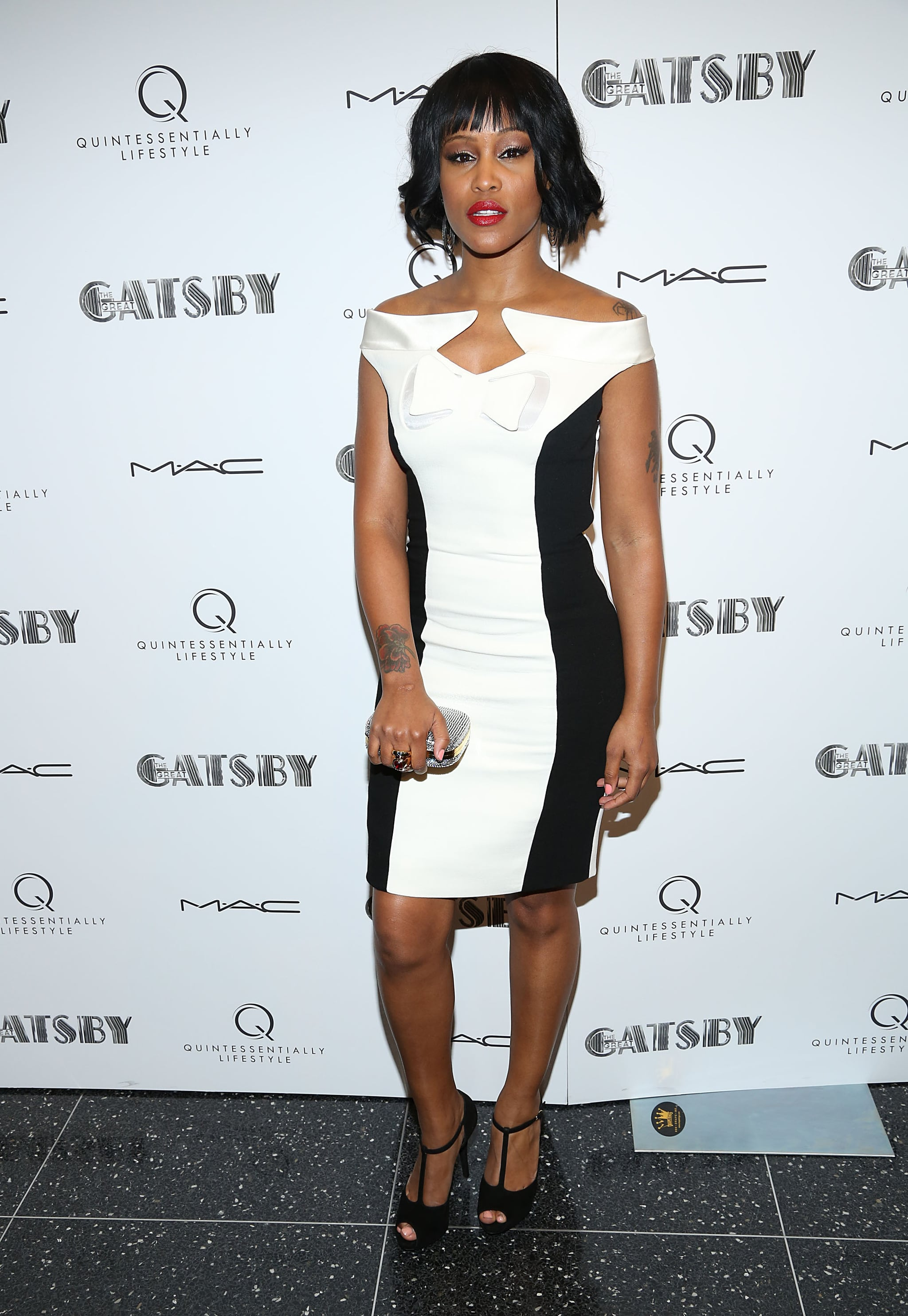 Eve showed off Spring's black and white trend on a formfitting sheath dress, then finished the look with T-strap heels.