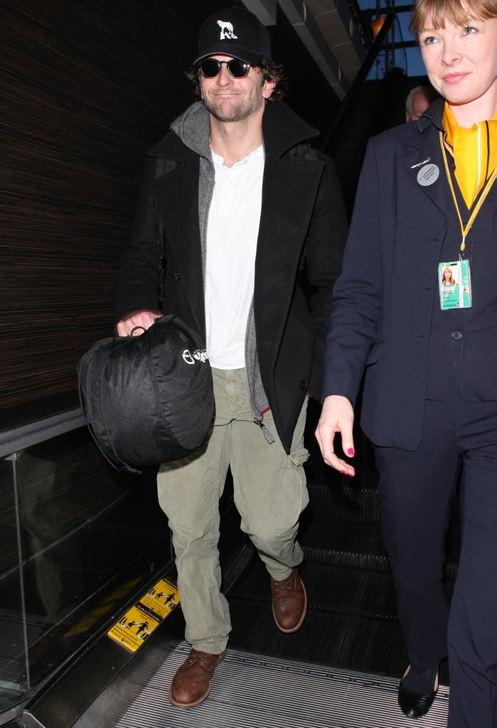 Bradley Cooper smiled as he made his way through the airport.