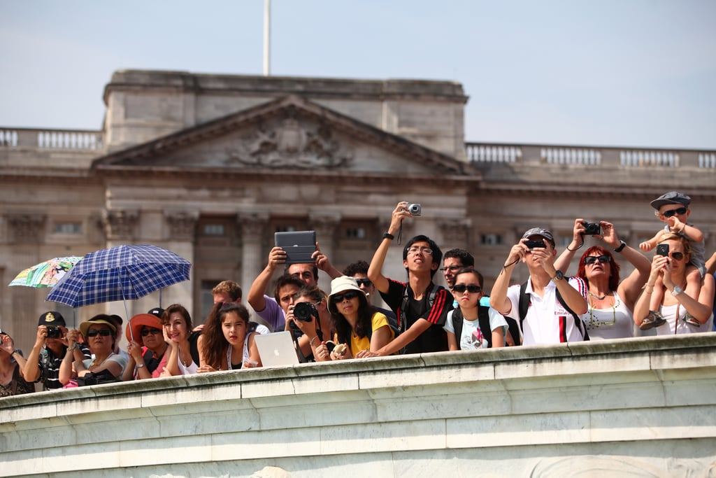 Crowds of people snapped pictures outside Buckingham Palace.
