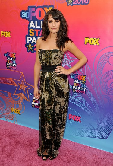 Lea proudly wears a marble print Giambattista Valli belted dress.