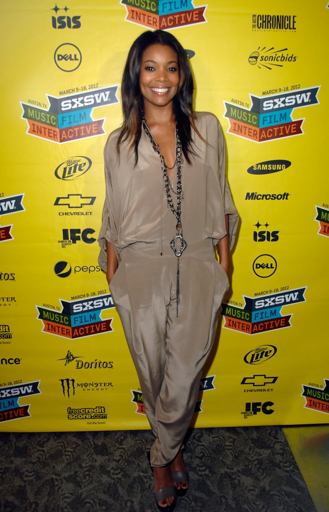 Gabrielle Union's silky jumpsuit lends an elegance with a totally casual, easy shape. We also love how the neutral hue offsets her accessories.