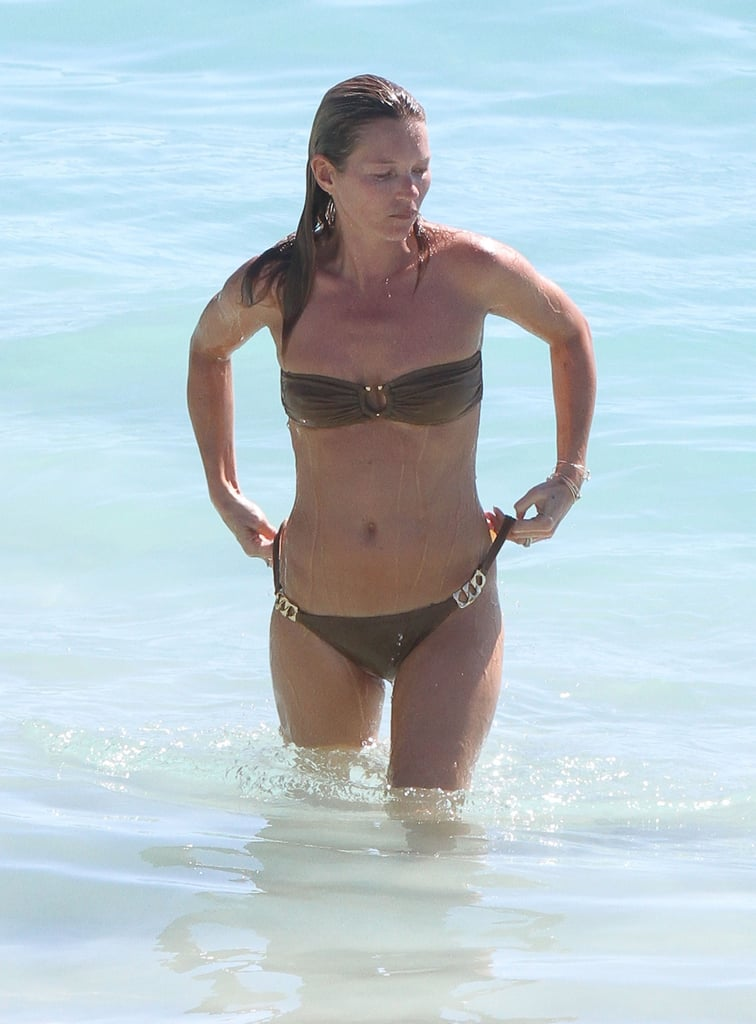 Bikini-clad Kate Moss took a dip in the water while vacationing in St. Barts.