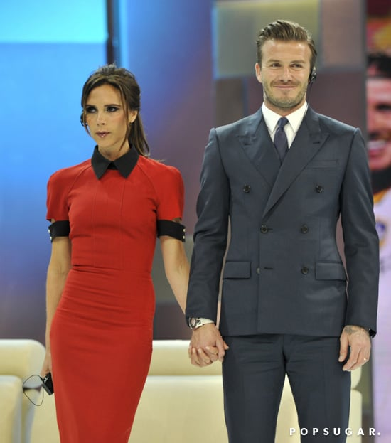Victoria Beckham and David Beckham held hands for their appearance on China Central Television.
