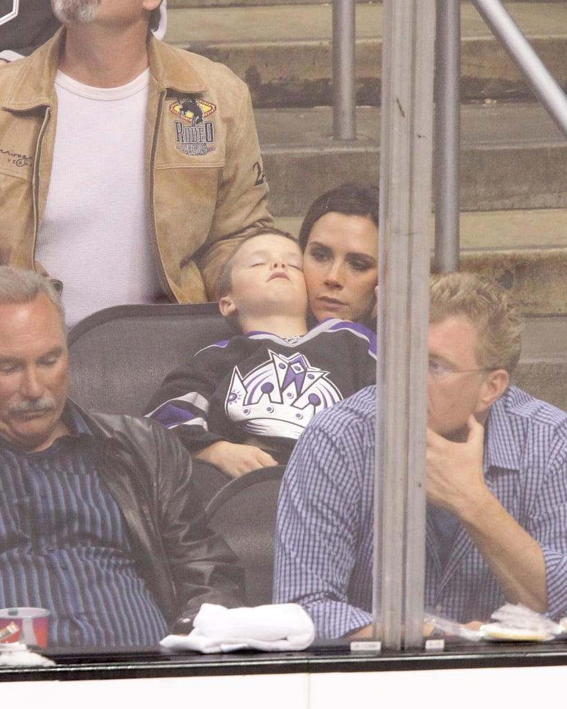 Cruz Beckham fell asleep on mom Victoria Beckham at the hockey game in LA.