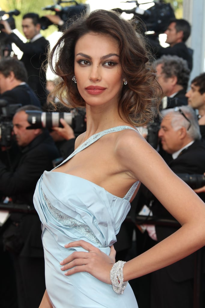 To complete her look, Madalina Ghenea opted for a statement bracelet, stud earrings, and rouge pout.