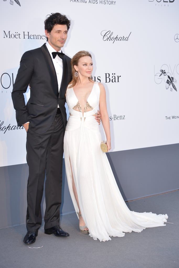 Andrés Velencoso and Kylie Minogue huddled up on the red carpet on Thursday for the amfAR gala in Cannes.