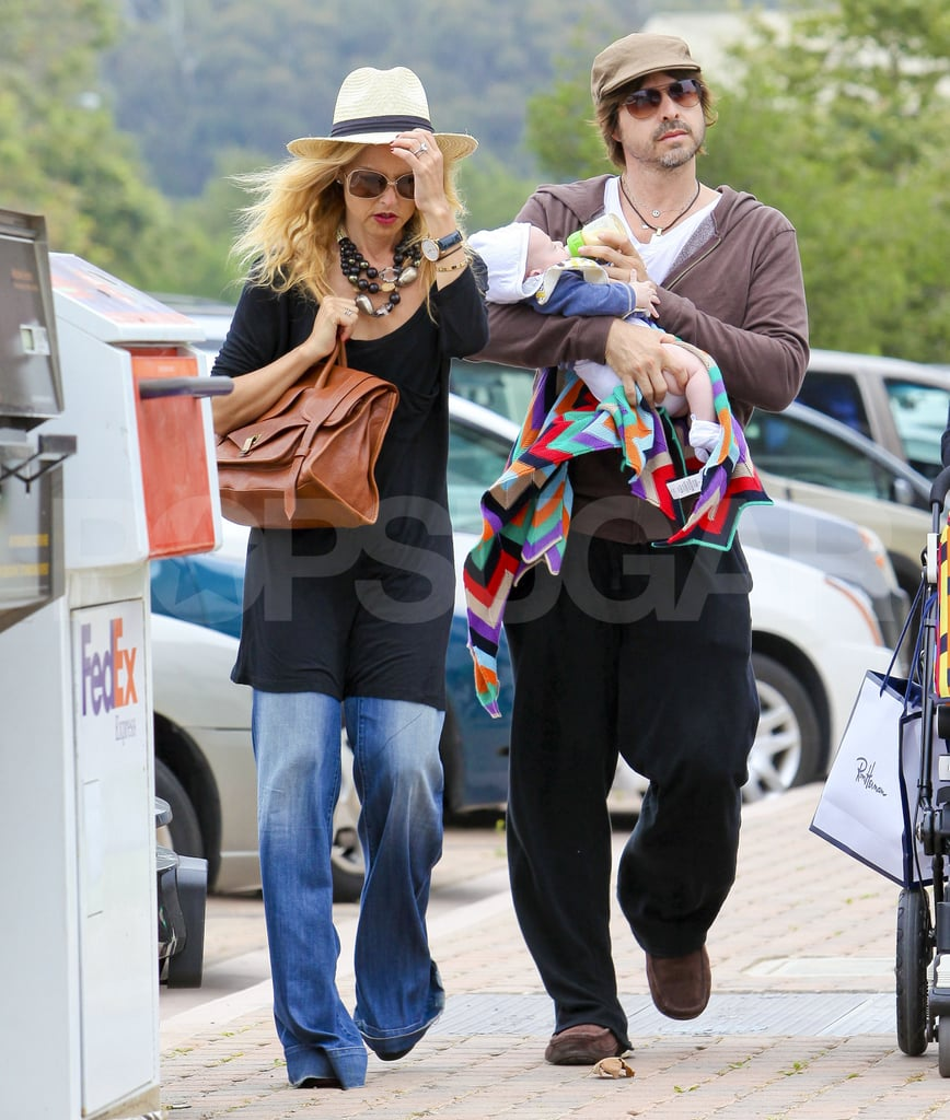 Rachel Zoe and Rodger Berman carried their infant, Skyler Berman, as they fit in some retail therapy.