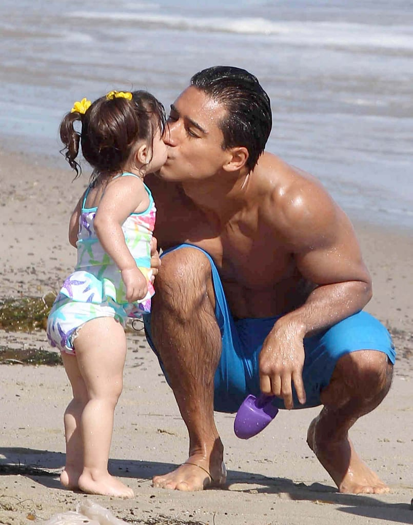 Mario Lopez kissed his daughter, Gia, at an LA beach in July.