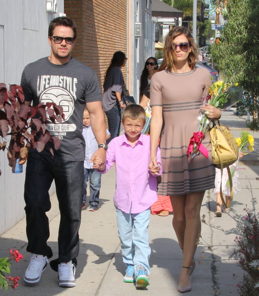 Mark Wahlberg went to a party in West Hollywood with his wife, Rhea, and son Michael.