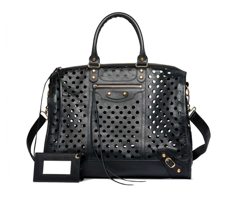 """My newest mission is finding a way to get this bag. I've always had a thing for the street-styled cool of a Balenciaga bag, but this one's perforated detailing makes it even more covetable. I think of this as the kind of purchase that could forever change my wardrobe — it would even make jeans and a white tank look chic."" — Hannah Weil, assistant editor  Balenciaga Kraft Polka Dot Bag ($1,795)"
