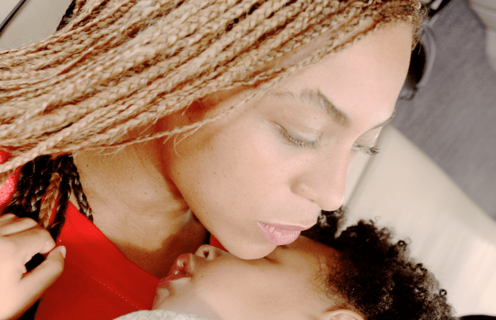 Beyoncé and Blue cuddled up.  Source: Beyonce.com