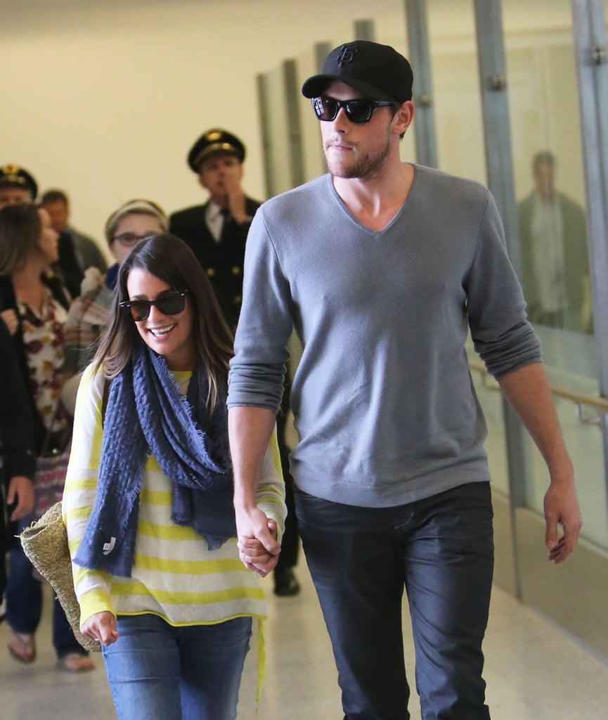 Lea Michele smiled as she arrived at LAX with boyfriend Cory Monteith.