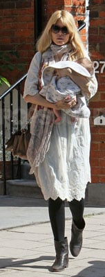 Claudia Schiffer Wears White Dress in London With Baby Cosima