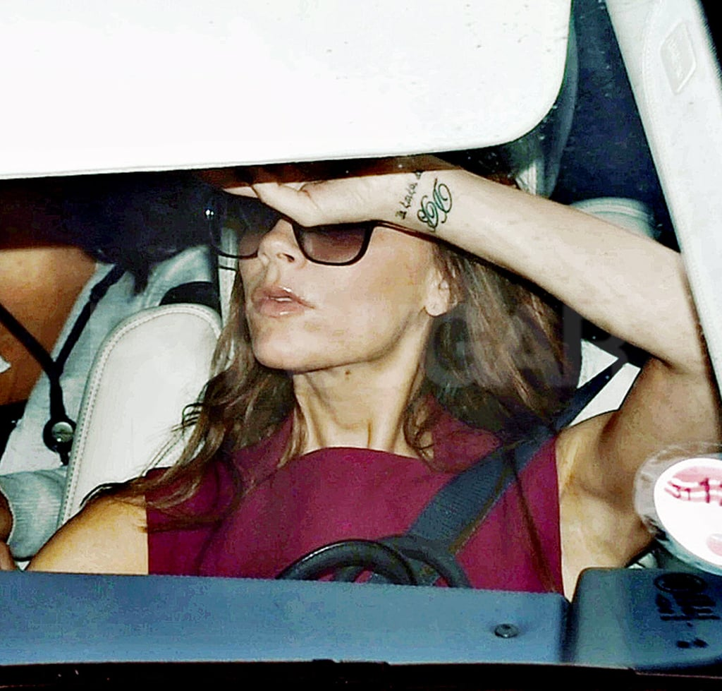 Victoria Beckham checked her mirror while in London.
