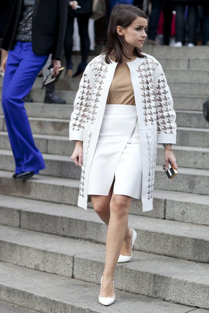 Miroslava Duma made an appearance in a laser-cut white coat and coordinating miniskirt.
