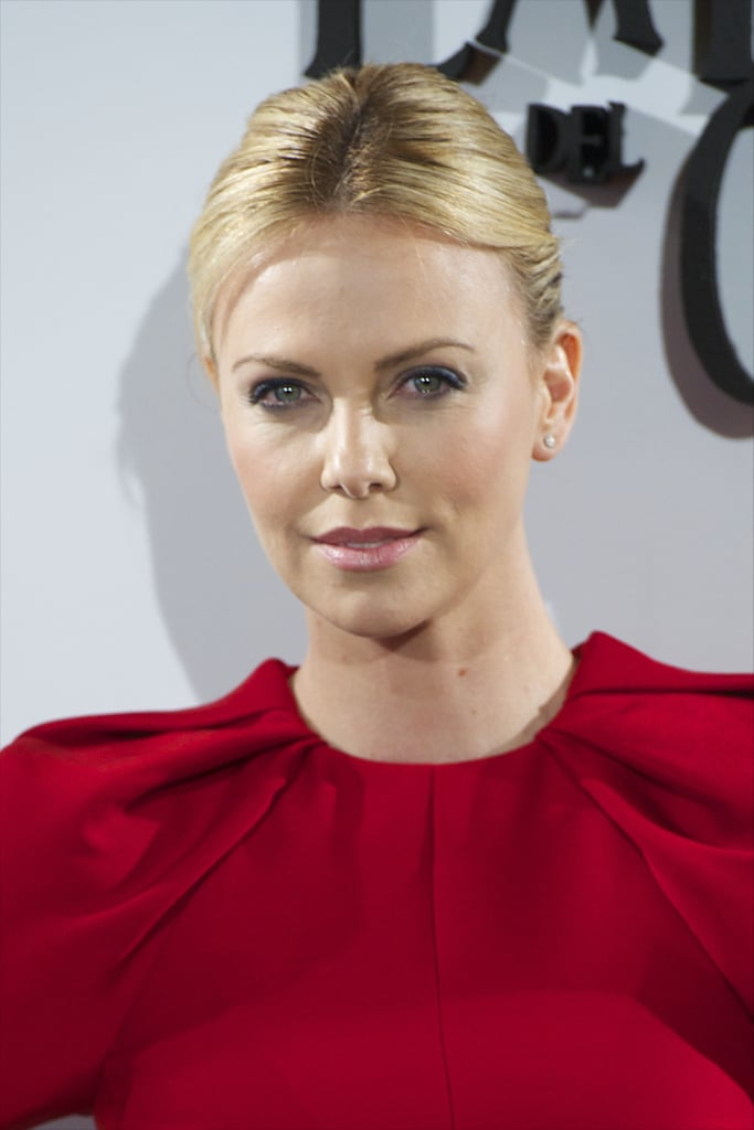 Charlize Theron smiled at the Snow White and the Huntsman photocall in Madrid.